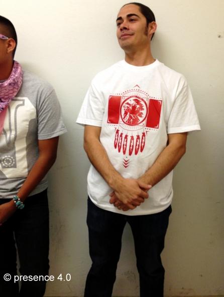 Model L-R: Left model beaded wayfarers by Candace Halcro, Diné bizaad bandana by David Sloan, shirt by Jared Yazzie for OXDX, turquoise bracelet is model's own. Right model: shirt by Jared Yazzie for OXDX.
