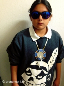 Beaded wayfarers by Candace Halcro, quilled medallion by Ista Ska, sweater by Jared Yazzie for OXDX