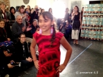 One of our mini-models wearing an Alanzo Edzerza red tunic with The Soft Museum earrings.