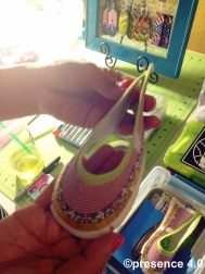 A pair of colorful baby ballet flats in progress.