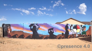 The students' mural composition, featuring their many backgrounds.