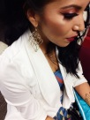 Jewelry closeup: KDD earrings and cuff.